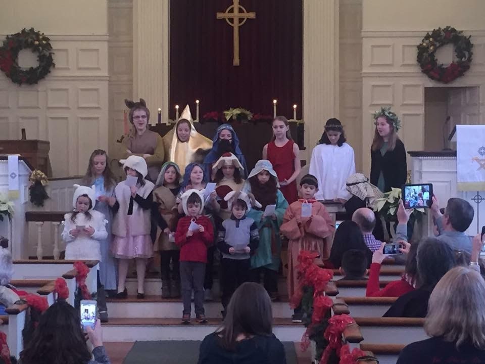 children singing in a church pageant