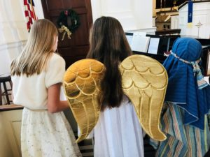 children of the choir dressed as angels and a shepard