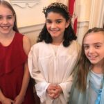three young girls before singing a church choir