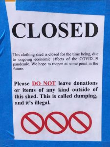 clothing drop-off shed sign temporarily closed