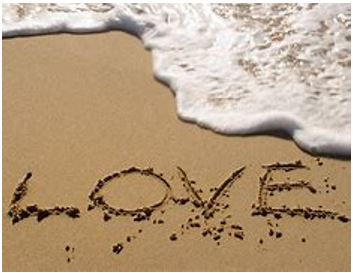 Love written in the sand on a beach